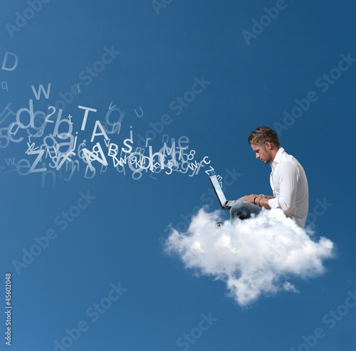 Fotografia  Businessman works over a cloud