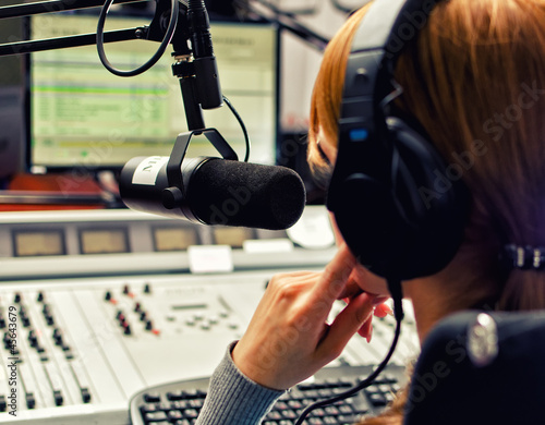 Rear view of female dj working in front of a microphone Canvas Print