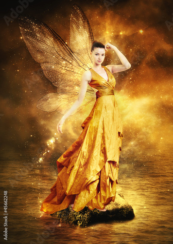 Valokuva  Magical young woman as golden fairy