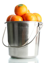 Ripe Tangerines In Metal Bucke...