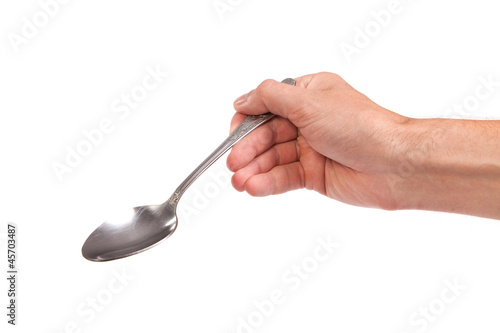 Valokuva  Hand is holding a spoon isolated