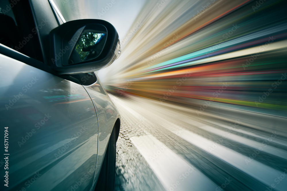 Fototapeta Car driving in city, blurred motion background.