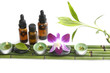 Set of fresh leaf and massage oil with orchid on bamboo grove