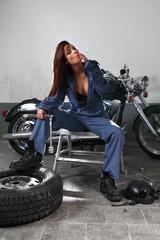 Fototapeta na wymiar Sexy female motorcycle mechanic