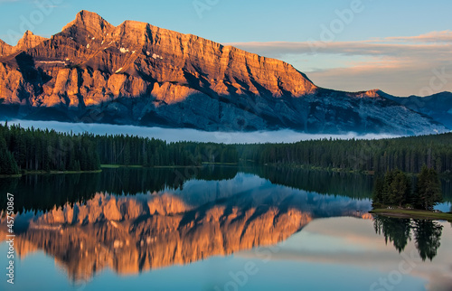 Fototapete - Orange Mountain Reflection in Lake Minnewanka