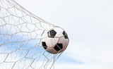 Fototapeta Sport - football in the goal net