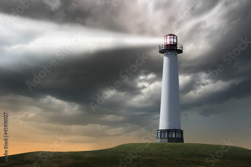 Fotobehang Vuurtoren Lighthouse beaming light ray over stormy clouds