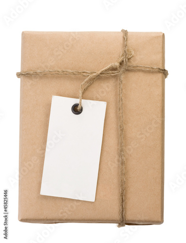 Fotografía  parcel wrapped packaged box and label on white