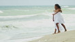 African American girl have fun with mother on beach