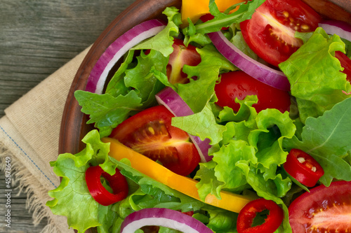 Fotografie, Obraz  Fresh Salad in a bowl on wooden background