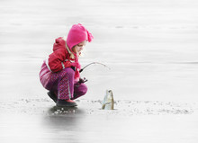 Little Child Fishing On A Froz...