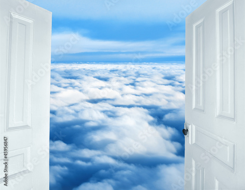 Photo  Doors opening to a heavenly sight of fluffy clouds