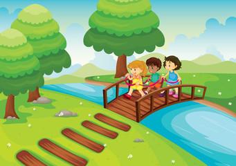 Obraz na płótnie Canvas kids crossing bridge