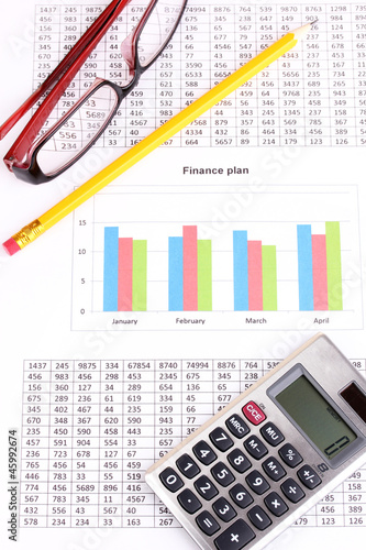 Documents, calculator and glasses close-up. - 45992674