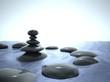 Zen stones in water, blue sky