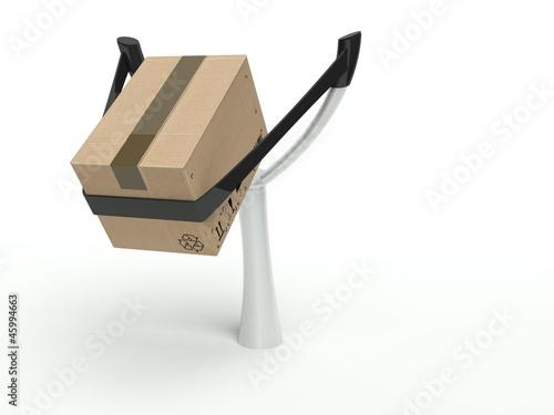 Valokuva Metaphor for express delivery, cardboard box on a slingshot