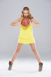 Young blond woman posing and holding basket ball