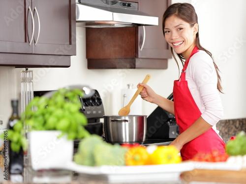 Fotografie, Obraz  Cooking woman in kitchen