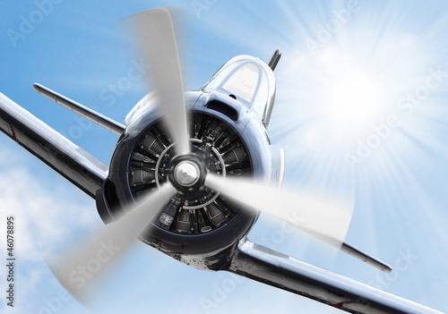 Fototapety, obrazy: The Fighter - old propeller plane. Retro technology theme.