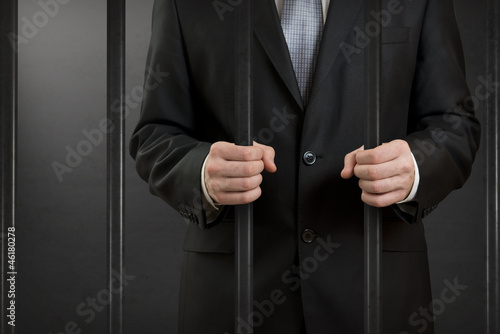 Photo  Businessman in jail close up