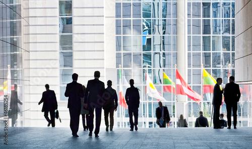 Foto op Canvas Brussel People walking against a light background.