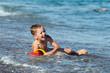Child boy on sea beach