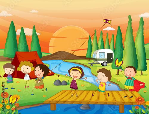 Canvas Prints River, lake a river, a bench and kids