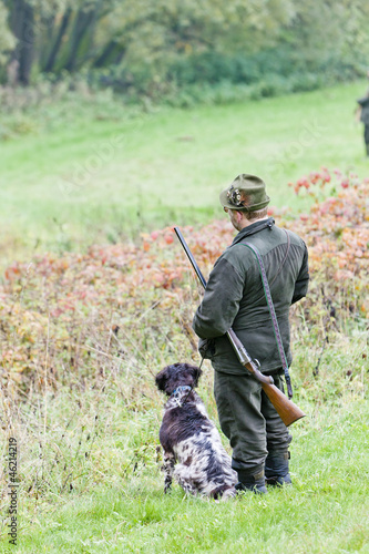 Fotografie, Obraz  hunter with his dog hunting