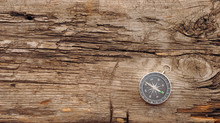 Compass On The Old Wooden Back...