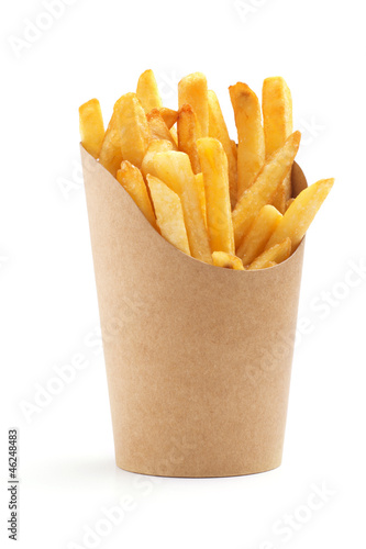 Photo french fries in a paper wrapper
