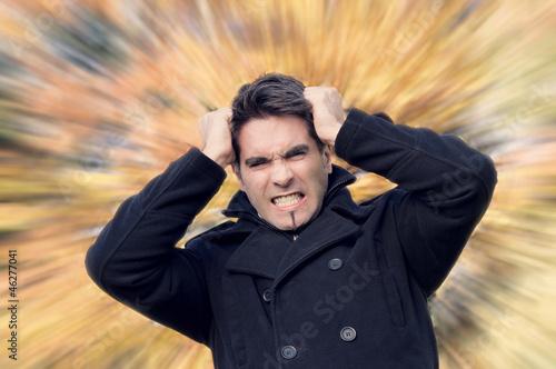 Fotomural Mann raufft sich die Haare