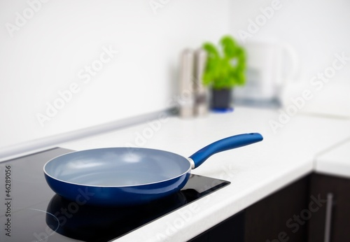 Fotografie, Obraz  Frying pan in modern kitchen with induction stove