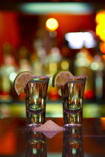 Two Shots Of Tequila With Lime...