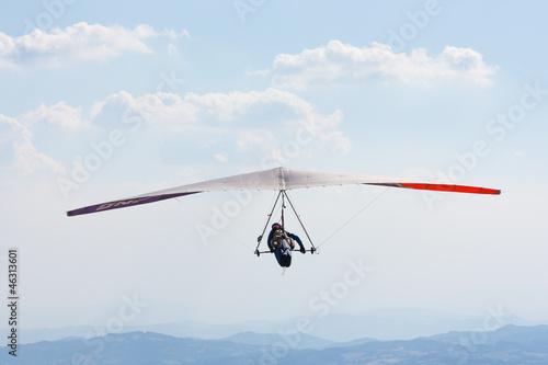 Canvas Prints Sky sports Deltaplano tra le nuvole