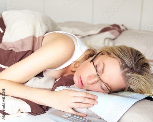 Valokuva  Exhausted woman sleeping in her glasses