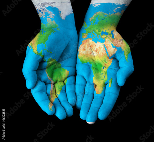Foto op Plexiglas Noord Europa Map painted on hands showing concept - the world in our hands
