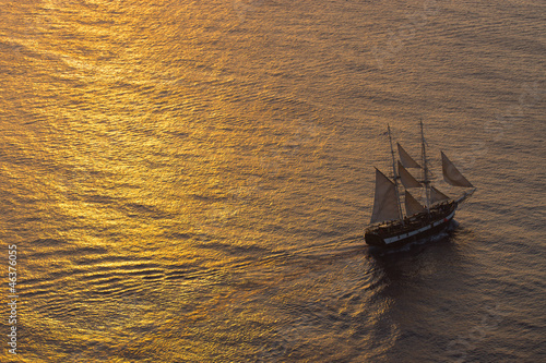 Photo Stands Ship Ship sailing at sunset