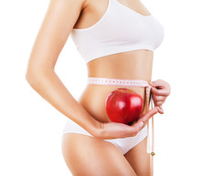 Sporty Woman With Red Apple And Measure