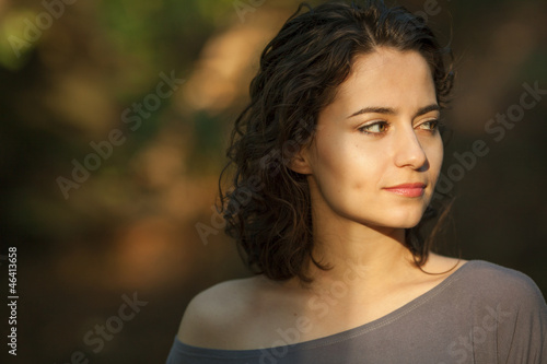 Photo  Young brunette woman with natural makeup and curly hair