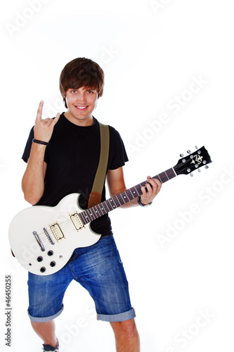 In de dag Art Studio Portrait of handsome man posing on white background with guitar