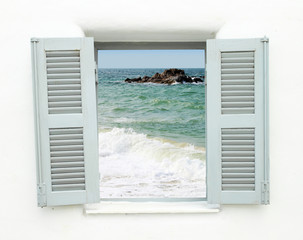 Fototapeta Greek style window with sea view