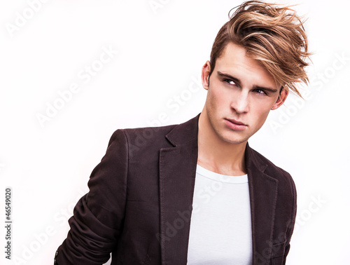 Fototapeta Elegant young handsome man. Studio fashion portrait.