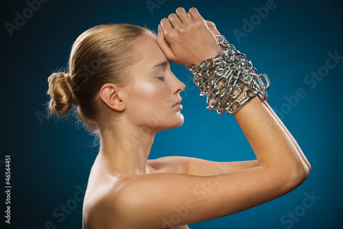 Closeup of beautiful female model with chained hands Poster Mural XXL
