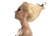 Leinwanddruck Bild blonde girl with dark make-up in profile