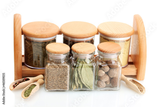 Foto op Canvas Kruiden 2 jars and wooden spoons on shelf with spices isolated on white