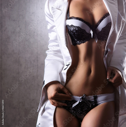 Sexy body of a young woman posing in erotic clothes