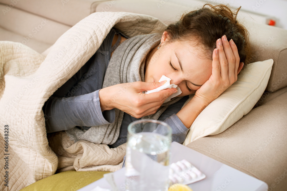 Fototapeta Sick Woman. Flu. Woman Caught Cold. Sneezing into Tissue