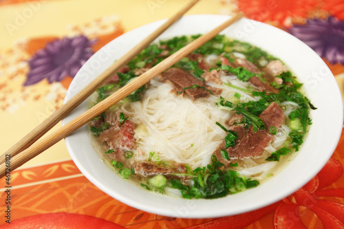 Photo  Traditional Vietnamese soup Pho with rice noodles and meat