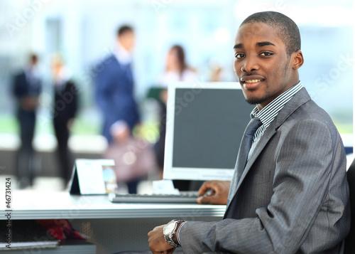 Fényképezés  African American entrepreneur displaying computer