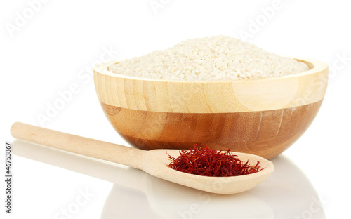 Foto op Canvas Kruiden 2 stigmas of saffron in wooden bowl with spoon isolated